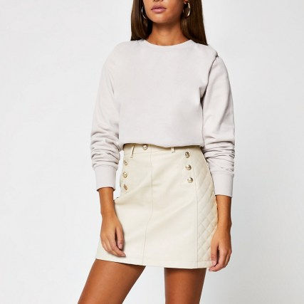 River Island Stone PU quilted mini skirt – neutral button detail skirts – faux leather fabrics - flipped
