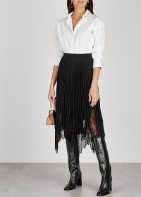 TORY BURCH Black lace-trimmed pleated midi skirt / feminine black semi sheer skirts / handkerchief hemline