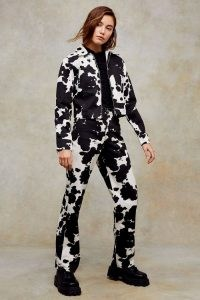 CONSIDERED Cow Print Denim Jacket And 90s Straight Jeans Co-Ord ~ monochrome animal prints ~ black and white fashion co ords ~ jackets and trouser sets
