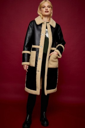 TOPSHOP IDOL Black PU And Borg Long Reversible Coat / faux leather and textured fur winter coats - flipped