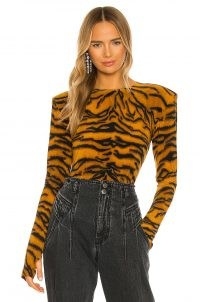 Norma Kamali Shoulder Pad Long Sleeve Crew Top in Tiger – glamorous animal print tops