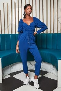 patricia bright puff sleeve jogger jumpsuit in blue / jumpsuits / celebrity fashion collarborations