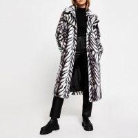 RIVER ISLAND White long line faux fur zebra print coat / glamorous winter coats / glamour / monochrome animal prints