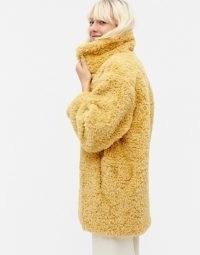 Monki Curly faux fur coat in beige / textured coats
