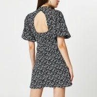 River Island Black puff sleeve floral print mini dress | cut out back volume sleeved dresses