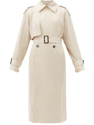 Chrissy Teigen cream trench, THE ROW Yeli double-breasted maxi trench coat, boarding a private jet in Los Angeles, 19 January 2021 | celebrity coats - flipped