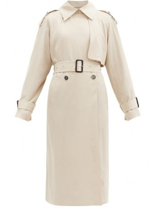 Chrissy Teigen cream trench, THE ROW Yeli double-breasted maxi trench coat, boarding a private jet in Los Angeles, 19 January 2021 | celebrity coats