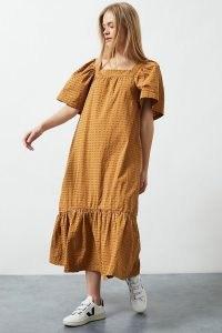 Beaumont Organic x Anthropologie Ruffled Midi Dress in Gold