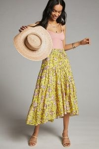Anthropologie Clarabelle Maxi Skirt in yellow, with a pretty floral print is an essential addition to any spring and summer wardrobe. Featuring a drawstring waist and on-trend tiers, it can be worn with a strappy camisole, fresh white crop tee or even a cropped sweater.