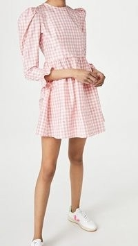 BATSHEVA Collarless Mini Prairie Dress is made from silk taffeta with a pink gingham check print and boasts puff shoulders, 3/4 length sleeves and ruffle detail cuffs.