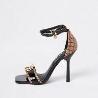 RIVER ISLAND Black RI monogram high heel – logo print heels – anhle strap shoes