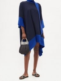 TALLER MARMO Palm Beach satin-panel crepe dress in blue / dipped hem dresses / fluid fabric clothing