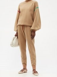 ROKSANDA Ponza drawstring-waist knitted track pants / beige soft knit joggers with a patch pocket detail and striped cuffs on the hem. Perfect for a sports luxe look.