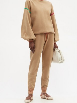 ROKSANDA Ponza drawstring-waist knitted track pants / beige soft knit joggers with a patch pocket detail and striped cuffs on the hem. Perfect for a sports luxe look. - flipped