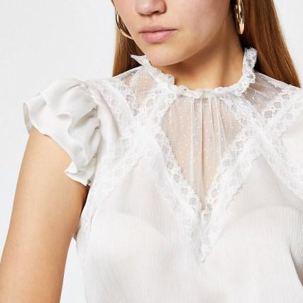 RIVER ISLAND White mesh high neck top – feminine frill detail tops - flipped