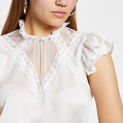 RIVER ISLAND White mesh high neck top – feminine frill detail tops