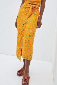 Anthropologie Sabia Wrap Midi Skirt | bright floral tie waist summer skirts