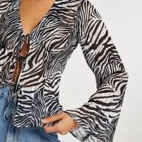 RIVER ISLAND Black zebra print tie front blouse / flared sleeve blouses