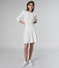 REISS CHARLOTTE KNITTED RUFFLE HEM DRESS / white long sleeve drop waist fit and flare dresses