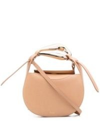 Chloé small Kiss purse in sandy beige / small luxe shoulder bags / sculptural mental top handle bag