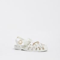 RIVER ISLAND Cream fisherman jelly sandals / caged PVC stud and gem embellished ankle strap flats