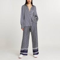 RIVER ISLAND Navy RI monogram jogger wide leg trousers / printed jogging bottoms