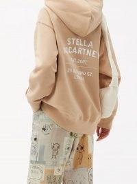 STELLA MCCARTNEY Old Bond Street-print cotton hooded sweatshirt ~ pale pink pullover slogan hoodies