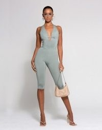 WMNSwear plunge buckle detail halterneck cropped jumpsuit in sage ~ green crop leg all in one with a plunging V-neck and a fitted silhouette