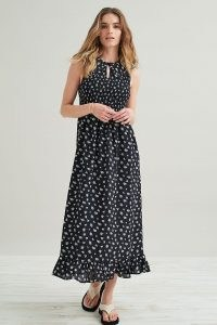 Kirei Smocked Maxi Dress / black floral sleeveless dresses with frill hem and front keyhole cut out