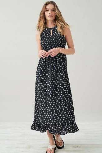 Kirei Smocked Maxi Dress / black floral sleeveless dresses with frill hem and front keyhole cut out - flipped