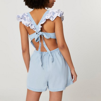 River Island Blue frill denim playsuit | tie back detail playsuits - flipped