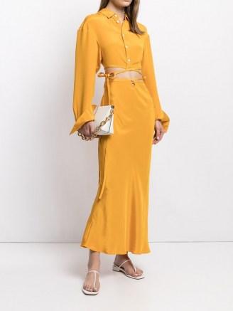 Christopher Esber cut-out tie skirt in mango yellow | fluid silk skirts - flipped