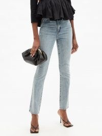 KHAITE Daria Santa Fe faded-wash slim-leg jeans | light blue faded denim