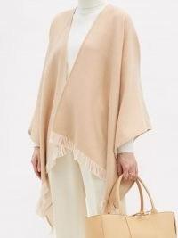 FENDI Logo-jacquard fringed wool poncho ~ neutral fringe trim capes