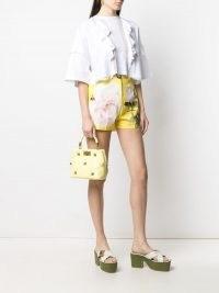 Valentino Garavani small Roman Stud top handle bag in pale lime yellow | small luxe studded handbag