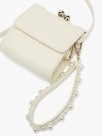 SIMONE ROCHA Faux pearl-embellished wristlet-strap leather bag ~ small white luxe bags ~ mini handbags