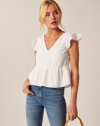 Abercrombie & Fitch Flutter Sleeve Trapeze Top | comfortable short-sleeve top in a soft linen-blend fabric and trapeze silhouette with on-trend flutter sleeves