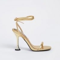 RIVER ISLAND Gold strappy flared heel sandals / metallic ankle tie high heels
