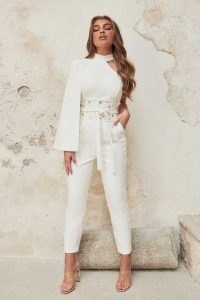 Lavish Alice high neck cape jumpsuit with corset belt in white | one shoulder fitted waist jumpsuits