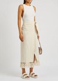 NANUSHKA Randi cream tasselled cotton wrap skirt – asymmetric side tie summer skirts with fringed hem