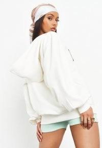 sean john x missguided ecru v neck balloon sleeve graphic hoodie ~ women's logo print hoodies