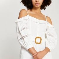 RIVER ISLAND White bardot belted lace trim playsuit ~ strappy cold shoulder playsuits
