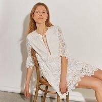 RIVER ISLAND White long sleeve lace tie front mini dress ~ romantic style semi sheer dresses