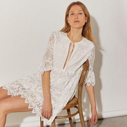 RIVER ISLAND White long sleeve lace tie front mini dress ~ romantic style semi sheer dresses - flipped