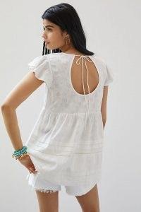 Maeve Textured Open-Back Tunic Blouse | womens white V-neck blouses | Anthropologie summer clothing | women's flutter sleeve tops