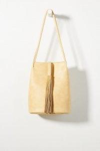 ANTHROPOLOGIE Tasseled Bucket Bag / womens stylish accessories / fringed detail shoulder bags