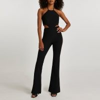 RIVER ISLAND Black halter neck cut out flared jumpsuit ~ glamorous evening jumpsuits ~ going out glamour