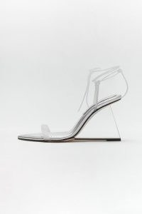 GOOD AMERICAN CINDER-F*CKING-RELLA WEDGE | strappy silver clear heel wedges