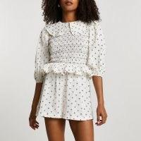 River Island Cream print collared playsuit | peplum waist playsuits | women's summer clothing | womens smocked bodice fashion | oversized collar trend