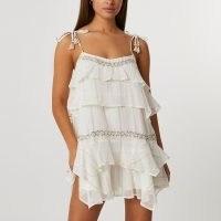 River Island Cream tiered mini beach dress | womens strappy vacation dresses | women's summer holiday fashion | beachwear | beach bar clothing | skinny strap